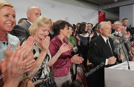 Polish Main Opposition Party Law and Justice (pis) Head and Presidential Candidate Jaroslaw Kaczynski (front-r) with His Elections Staff's Head Joanna Kluzik-rostkowska (3-l) His Niece the Daughter of the Late Polish President Lech Kaczynski Marta Kaczynska-dubieniecka (back 4-r) Pis Mp Jolanta Szczypinska (2-l) and Kaczynski's Staff Spokesperson Pawel Poncyljusz (back-r) During Kaczynski's Presidential Elections Night Held in Warsaw Poland on 04 July 2010 According to the State Electoral Commission (pkw) Announcement Early 05 July Presenting Partial Unofficial Results From 95 Per Cent of All Constituencies Komorowski Won with 52 63 Per Cent of Votes While Kaczynski Got 47 37 Per Cent Poland Warsaw