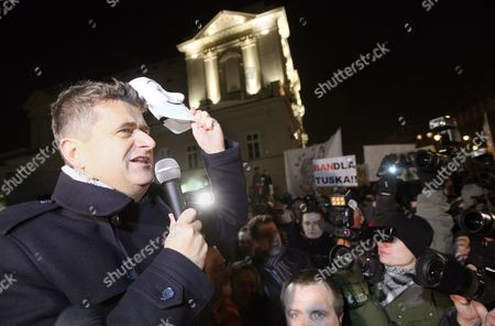 Leader of Palikot Movement Party Janusz Palikot (l) Speaks During a Demonstration Against the Ratifying of the Anti-counterfeiting Trade Agreement (acta) in Warsaw Poland 27 January 2012 Controversial Acta Signed by Poland on 26 January Commits Its Signatories to Counteract Global Trade of Counterfeit Goods and Pirated Copyright Opponents Have Argued That the Treaty Will Restrict Fundamental Civil and Digital Rights Including the Freedom of Expression and Communication Privacy Poland Warsaw
