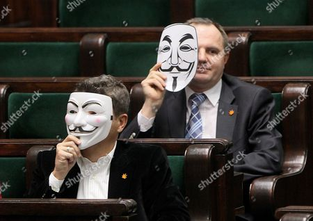 Leader of Palikot Movement Party Janusz Palikot (l) and Member of Pm Party Jacek Kwiatkowski (r) Hold Up Masks to Protest the Ratifying of the Anti-counterfeiting Trade Agreement (acta) at the Parliament (sejm) in Warsaw Poland 26 January 2012 Poland on 26 January Signed an International Treaty Aimed at Protecting Copyright and Curbing Online Piracy Despite Countrywide Street Protests the Countrys Ambassador to Japan Jadwiga Rodowicz-czechowska Signed the Anti-counterfeiting Trade Agreement (acta) in Tokyo Poland Warsaw