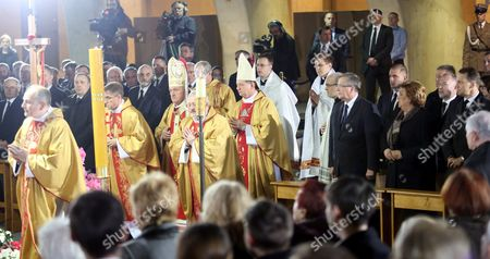 President of Poland Bronislaw Komorowski (4-r) with His Wife Anna Komorowska (3-r) and Sejm Speaker Radoslaw Sikorski (r) Polish Foreign Minister Grzegorz Schetyna (3-l) and National Security Bureau Chief Stanislaw Koziej (l) Attend For a Holy Mass at the Temple of Divine Providence As Part of Celebrations Marking the 5th Anniversary of the Polish Presidential Plane Crash in Smolensk in Warsaw Poland 10 April 2015 Poland's President Lech Kaczynski His Wife Maria Kaczynska and 94 Others Died on 10 April 2010 when Polish Presidential Plane Crashed in Smolensk Russia Poland Warsaw