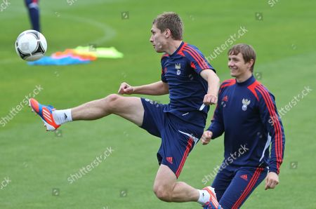 Russian National Soccer Team Player Kirill Nababkin (l) and Roman Pavlyuchenko During the Team's Training Session in Sulejowek Poland 14 June 2012 Russia Will Face Greece in a Group a Soccer Match of the Uefa Euro 2012 Soccer Championship in Warsaw on June 16 Poland Sulejowek