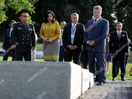 Ukrainian President Petro Poroshenko (2-r) with Ukrainian Ambassador to Poland Andrii Deshchytsia (3-r) and Ukrainian Deputy Prime Minister Ivanna Klympush-tsintsadze (2-l) Lay Flowers at the Volyn Slaughter Monument in Warsaw Poland 08 July 2016 President Poroshonko is Currently Taking in the Nato Warsaw Summit Poland Warsaw