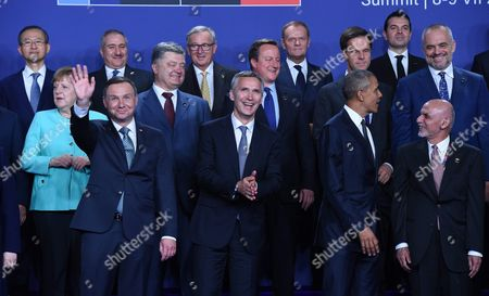 First Row (l-r) Polish President Andrzej Duda Nato Secretary General Jens Stoltenberg Us President Barack Obama Afghan President Ashraf Ghani; Second Row (l-r) German Chancellor Angela Merkel Ukrainian President Petro Poroshenko British Prime Minister David Cameron Dutch Prime Minister Mark Rutte Albanian Prime Minister Edi Rama; Third Row (l-r) World Bank President Jim Yong Kim Jordanian Foreign Minister Nasser Judeh European Commission President Jean-claude Juncker European Council President Donald Tusk and Macedonia's Foreign Minister Nikola Poposki Pose For a Family Photo at the Opening of the Nato Summit at the National Stadium in Warsaw Poland 08 July 2016 the Nato Warsaw Summit Which is Expected to Decide About Military Reinforcements on Nato Territory in Central-east Europe Takes Place on 08 and 09 July About 2 000 Delegates Including 18 State Heads 21 Prime Ministers 41 Foreign Ministers and 39 Defence Ministers Will Take Part in the Summit Poland Warsaw