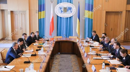 Polish Foreign Minister Radoslaw Sikorski (2-r) with Ukrainian Foreign Minister Andrii Deshchytsia (l) and Their Delegations Sit Together During the Annual Polish-ukrainian Foreign Ministry Consultations in Kiev Ukraine 16 May 2016 the Ministers Were Signing an Agreement on Cooperation Between Their Ministries For the Years 2014-2015 Which Includes Political Consultations of Representatives of the Weimar Triangle and the Visegrad Group Countries with the Ukrainian Authorities As Well As Regular Meetings of Polish and Ukrainian Foreign Ministers and Organizing Training Seminars For Ukrainian Diplomats Ukraine Kiev