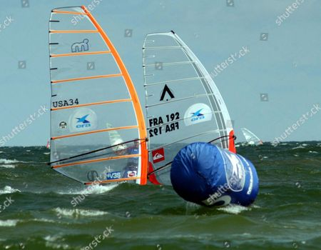 Micah Buzianis (l) From Usa and Antoine Albeau (r) From France Perform During of the Windsurfing Formula Racing World Cup in Leba Poland on Saturday 09 August 2003 Buzianis Von Competition Epa Photo/pap/stefan Kraszewski Poland Leba