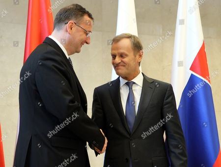 Polish Prime Minister Donald Tusk (r) and Outgoing Czech Prime Minister Petr Necas (l) Shake Hands Shake Hands Before a Visegrad Group Meeting Ahead of the Eu Summit in Brussels Belgium 27 June 2013 European Union Leaders Will Meet For a Two-day Summit Amid High Expectations For Progress on Everything From the Bloc's Economic Crisis to Its Enlargement Belgium Brussels