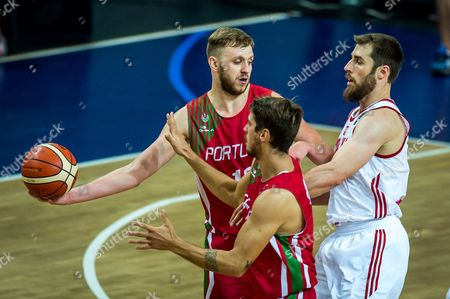 Stock Picture of Portugal's Joao Guerreiro (l) and Joao Soares (c) with Poland's Aleksander Czyz (r) in Action During the Fiba Eurobasket 2017 Qualifying Group D Match Between Poland and Portugal in Wloclawek Poland 31 August 2016 Poland Wloclawek