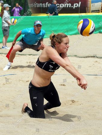 Michelle Stiekema of the Netherlands in Action During Her Qualifying Round Match with Jolien Sinnema Against Zara Dampney and Lucy Boulton of Britain at the Beach Volleyball World Championships in Stare Jablonki Poland 01 July 2013 Poland Stare Jablonki