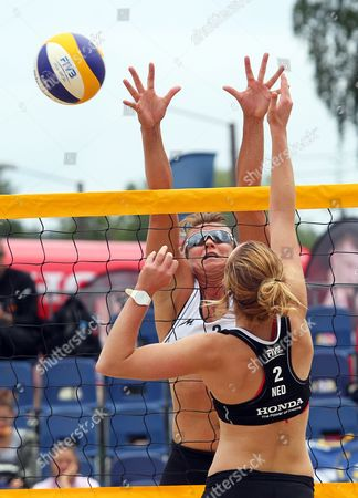 Jolien Sinnema (front) of the Netherlands in Action Against Lucy Boulton (back) of Britain During Their Qualifying Round Match of the Beach Volleyball World Championships in Stare Jablonki Poland 01 July 2013 Poland Stare Jablonki