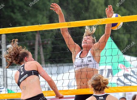 Jolien Sinnema (r) and Michelle Stiekema (l) of the Netherlands in Action Against Lucy Boulton (c) of Britain During Their Qualifying Round Match at the Beach Volleyball World Championships in Stare Jablonki Poland 01 July 2013 Poland Stare Jablonki