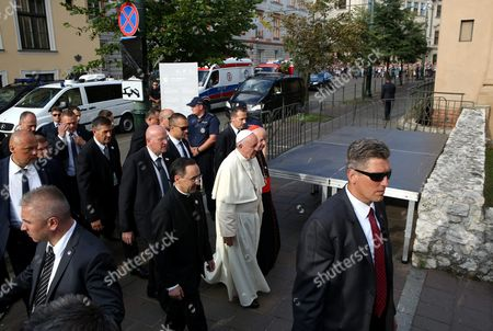 Pope Francis (c) with Metropolitan of Krakow Cardinal Stanislaw Dziwisz (2-r) Priest Mauricio Rueda Beltz (2-l) Walk After a Visit to the Fransciscan Monastry in Krakow Poland 30 July 2016 the Pope is Going to Particpate in the Night Vigil with Participants of World Youth Day 2016 at the Campus Misericordiae in Brzegi the World Youth Day 2016 is Held in Krakow and Nearby Brzegi From 26 to 31 July Poland Krakow