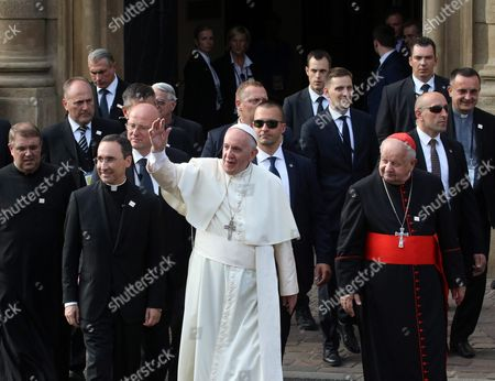 Pope Francis (c) with Metropolitan of Krakow Cardinal Stanislaw Dziwisz (r) Priest Robert Wozniak (l) and Priest Mauricio Rueda Beltz (2-l) Walk From Cracow Archbishops' Palace to the Nearby Fransciscan Monastry in Krakow Poland 30 July 2016 the Pope is Going to Particpate in the Night Vigil with Participants of World Youth Day 2016 at the Campus Misericordiae in Brzegi the World Youth Day 2016 is Held in Krakow and Nearby Brzegi From 26 to 31 July Poland Krakow