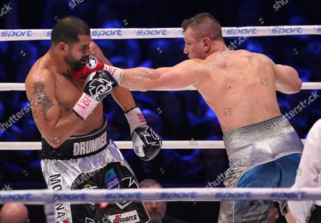 Polish Boxer Tomasz Adamek (r) and Us Boxer Eric Molina (l) Exchange Punches During the Bout For Heavyweight Ibf Intercontinental Belt at Tauron Arena in Krakow Poland 02 April 2016 Molina Won After Knocking out Adamek in the 10th Round Poland Krakow