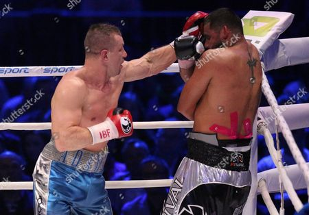 Polish Boxer Tomasz Adamek (l) and Us Boxer Eric Molina (r) Exchange Punches During the Bout For Heavyweight Ibf Intercontinental Belt at Tauron Arena in Krakow Poland 02 April 2016 Molina Won After Knocking out Adamek in the 10th Round Poland Krakow