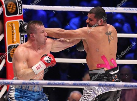 Stock Image of Polish Boxer Tomasz Adamek (l) and Us Boxer Eric Molina (r) Exchange Punches During the Bout For Heavyweight Ibf Intercontinental Belt at Tauron Arena in Krakow Poland 02 April 2016 Molina Won After Knocking out Adamek in the 10th Round Poland Krakow