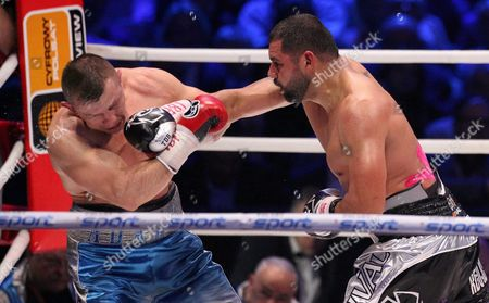 Stock Picture of Polish Boxer Tomasz Adamek (l) and Us Boxer Eric Molina (r) Exchange Punches During the Bout For Heavyweight Ibf Intercontinental Belt at Tauron Arena in Krakow Poland 02 April 2016 Molina Won After Knocking out Adamek in the 10th Round Poland Krakow