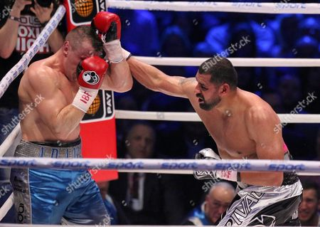 Stock Photo of Polish Boxer Tomasz Adamek (l) and Us Boxer Eric Molina (r) Exchange Punches During the Bout For Heavyweight Ibf Intercontinental Belt at Tauron Arena in Krakow Poland 02 April 2016 Molina Won After Knocking out Adamek in the 10th Round Poland Krakow