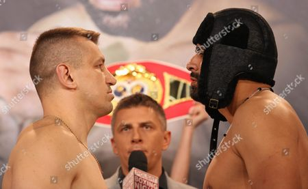 Polish Boxer Tomasz Adamek (l) and American Boxer Eric Molina (r) During the Weigh-in Ceremony Before Tomorrow's Bout For Heavyweight Ibf Intercontinental Belt in Krakow Poland 01 April 2016 Poland Krakow