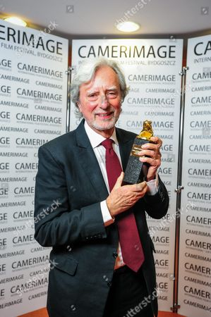 Us Director Philip Kaufman Poses with Camerimage Lifetime Achievement Award For Directing During the 22nd International Film Festival of the Art of Cinematography 'Camerimage' in Bydgoszcz Poland 22 November 2014 the Festival Ran From 15 to 22 November Poland Bydgoszcz