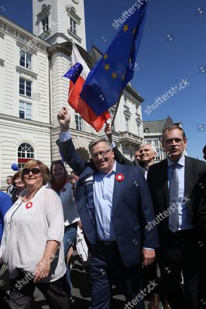 Stock Photo of Former President of Poland Bronislaw Komorowski (c) with His Wife Anna Komorowska (l) and Mayor of Berlin Michael Muellerem (r) Take Part in the Schuman's Parade to Commemorate Robert Schuman's Proposals For an Organised Europe in Warsaw Poland 07 May 2016 the March is an Expression of Support For European Integration and Polish Membership in the European Union This Year Parade is Under Slogan 'This is Europe!' Poland Warsaw