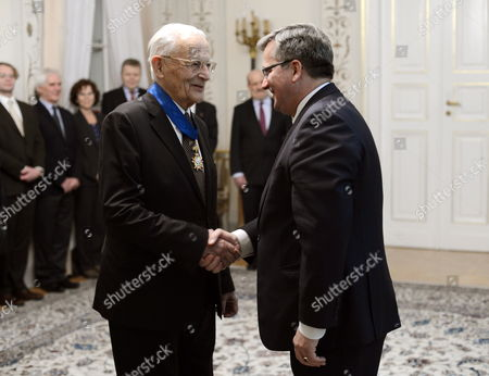 Stock Photo of French Sociologist Alain Touraine (l) Receives the Commander's Cross of the Order of Rebirth of Poland From Poland's President Bronislaw Komorowski (r) During Their Meeting in Warsaw Poland 18 December 2012 Touraine was Awarded For His Outstanding Support to the Democratic Transition and Political Transformation in Poland the Achievements in the Study of Social Movements and the Development of French-polish Scientific Cooperation in the Field of Sociology It was Said in the Laudatio Poland Warsaw