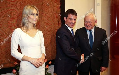 French Prime Minister Manuel Valls (c) Shakes Hands with the Democratic Left Alliance Leader Leszek Miller (r) Next to the Democratic Left Alliance Presidential Candidate Magdalena Ogorek (l) During Their Meeting at the French Embassy in Warsaw Poland 11 March 2015 Valls is in Poland For a Two-day Visit Poland Warsaw