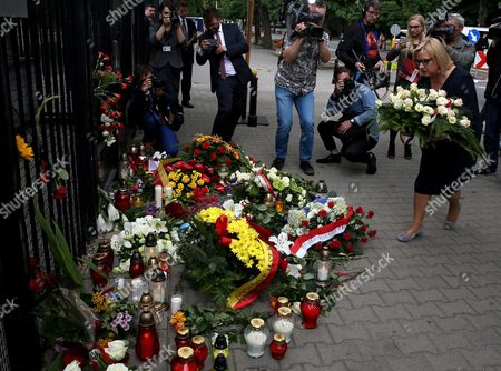 Stock Image of Head of Chancellery Beata Kempa (r) on Behalf of the Prime Minister Beata Szydlo Lays Flowers and Candles in Front of the French Embassy in Warsaw Poland 15 July 2016 According to Reports at Least 84 People Died and Many Were Wounded After a Truck Drove Into the Crowd on the Famous Promenade Des Anglais During Celebrations of Bastille Day in Nice Late 14 July Poland Warsaw