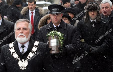 Michal Rusinek (r) Personal Secretary of Late Nobel-prize Winning Polish Poet Wislawa Szymborska Walks in the Funeral Procession at the Rakowicki Cemetry in Krakow Poland 09 February 2012 the Ceremony is Attended by President Bronislaw Komorowski and His Wife Prime Minister Donald Tusk Cabinet Members Mps and Representatives of the Diplomatic Corps Wislawa Szymborska Passed Away on 01 February 2012 at the Age of 89 Poland Krakow