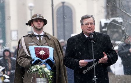 Poland's President Bronislaw Komorowski (r) Delivers a Speech During a Secular Ceremony For Late Polish Poet and Nobel Laureate Wislawa Szymborska at the Rakowicki Cemetry in Krakow Poland 09 February 2012 the Ceremony is Attended by President Bronislaw Komorowski and His Wife Prime Minister Donald Tusk Cabinet Members Mps and Representatives of the Diplomatic Corps Wislawa Szymborska Passed Away on 01 February 2012 at the Age of 89 Poland Krakow