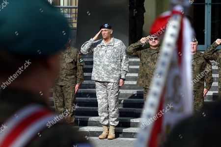 Chief of Staff of the Us Army General Raymond Odierno (c) During the Official Welcome Ceremony at the General Command of the Armed Forces Types in Warsaw Poland 09 June 2014 Later Today General Odierno Will Visit Drawsko Pomorskie Military Training Area to Watch Joint Polish Us Paratroopers Training General Odierno is on a Two-day Official Visit to Poland Poland Warsaw