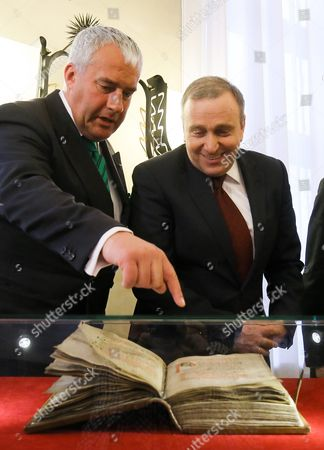 Polish Foreign Minister Grzegorz Schetyna (r) with Bavarian Minister of Education and Culture Science and Art Ludwig Spaenle (l) Look on The' Pontifical of Plock' Medieval Liturgical Book During a Returning Ceremony in Polish Foreign Ministry in Warsaw Poland 15 April 2015 the Manuscript Stolen by Nazis During Wwii and After War Located in the Bavarian State Library in Munich Returned to Poland After 75 Years Poland Warsaw