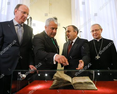 Polish Foreign Minister Grzegorz Schetyna (2-r) with Bavarian Minister of Education and Culture Science and Art Ludwig Spaenle (2-l) Bishop of Plock Piotr Libera (r) and Bavarian State Library Director Klaus Ceynowa (l) Look on The' Pontifical of Plock' Medieval Liturgical Book During a Returning Ceremony in Polish Foreign Ministry in Warsaw Poland 15 April 2015 the Manuscript Stolen by Nazis During Wwii and After War Located in the Bavarian State Library in Munich Returned to Poland After 75 Years Poland Warsaw