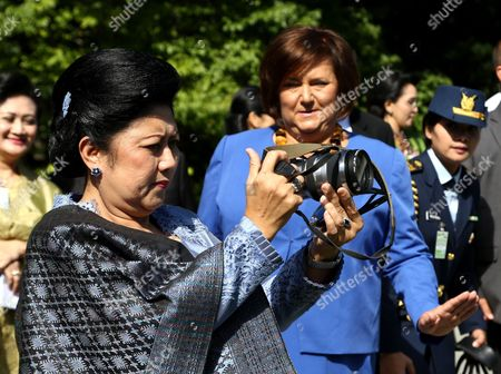 Poland's First Lady Anna Komorowska (r) Looks As Indonesian First Lady Ani Bambang Yudhoyono (l) Takes Picture in Palace's Garden During a Visit to the Palace Museum in Wilanow in Warsaw Poland 04 September 2013 President Yudhoyono and His Wife Are on an Official Visit to Poland Poland Warsaw