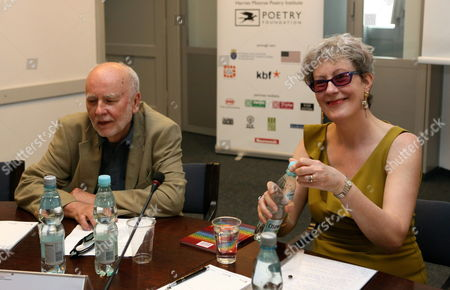 Polish Poet Adam Zagajewski (l) and Welsh Poet Gwyneth Lewis (r) Attend the Debate 'The Poetry and the Mass Culture' As Part of the 'Cracow Poetry Symposium' at the Jagiellonian Univeristy Collegium Maius in Cracow Poland 17 June 2013 Poland Cracow
