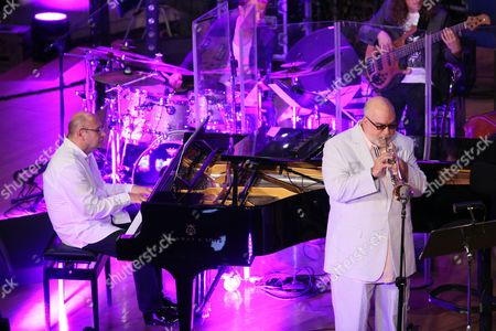 Polish Composer and Jazz Pianist Wlodek Pawlik (l) Performs on Stage with Us Trumpeter Randy Brecker (r) and the Cracow Philharmonic Orchestra Under the Baton of Polish Conductor Adam Klocek (unseen) During Their Concert 'Night in Calisia' in Krakow Poland 09 July 2014 Poland Krakow