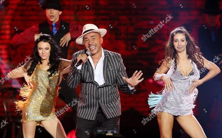 German Singer Lou Bega (c) Performs on Stage During the Concert at the Pge National Stadium in Warsaw Poland 24 September 2016 on Stage There Were the Biggest Stars of Disco Dance Poland Warszawa