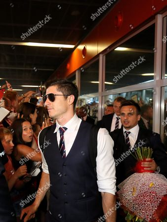 Polish National Soccer Team Players Robert Lewandowski (l) and Slawomir Peszko (r) Are Greeted by Supporters As They Arrive at the Airport After Returning From France in Warszaw Poland 01 July 2016 Poland Lost on Penalties to Portugal in the Quarter Final of the Uefa Euro 2016 in Marseille on 30 June Poland Warsaw