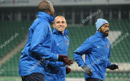 Trabzonspor Kulubu's Players Souleman Bamba (l) Adrian Mierzejewski (c) and Jose Bosingwa Warm Up During Their Team a Training Session in Warsaw Poland 06 November 2013 Legia Will Face Trabzonspor Kulubu in the Uefa Europa League Group J Soccer Match in Warsaw on 07 November 2013 Poland Warsaw