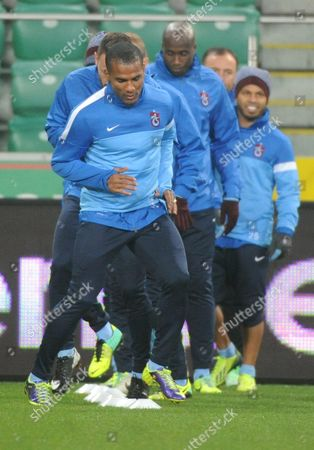 Trabzonspor Kulubu's Player Florent Malouda (c) Warms Up During His Team a Training Session in Warsaw Poland 06 November 2013 Legia Will Face Trabzonspor Kulubu in the Uefa Europa League Group J Soccer Match in Warsaw on 07 November 2013 Poland Warsaw