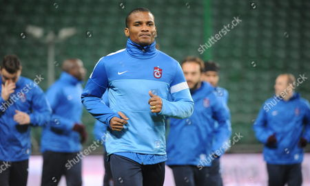 Trabzonspor Kulubu's Player Florent Malouda Warms Up During His Team a Training Session in Warsaw Poland 06 November 2013 Legia Will Face Trabzonspor Kulubu in the Uefa Europa League Group J Soccer Match in Warsaw on 07 November 2013 Poland Warsaw