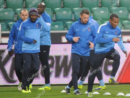 Trabzonspor Kulubu's Players (l-r) Adrian Mierzejewski D?guy Alain Didier Zokora Souleman Bamba Aykut Demir and Florent Malouda Warm Up During Their Team a Training Session in Warsaw Poland 06 November 2013 Legia Will Face Trabzonspor Kulubu in the Uefa Europa League Group J Soccer Match in Warsaw on 07 November 2013 Poland Warsaw