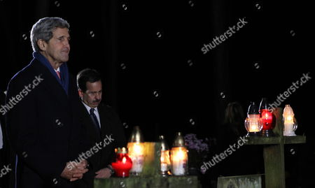 Us Secretary of State John Kerry (l) Lays Flowers at the Grave of Late Former Polish Prime Minister Tadeusz Mazowiecki at the Cemetery in Laski Near Warsaw Poland 04 November 2013 John Kerry is in Poland For Talks Ontrade Ties and in Discussions on Plans to Base a Us Missile Defence System Based in Poland in 2018 Poland Laski