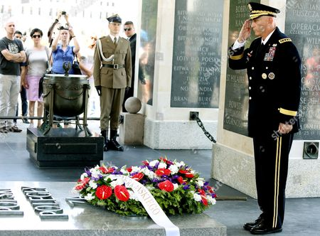 Chief of Staff of the Us Army General Raymond Odierno Salutes As He Lays a Wreath at the Tomb of Unknown Soldier at the Pilsudski Square in Warsaw Poland 08 June 2014 General Odierno is on a Two-day Official Visit to Poland Poland Warsaw