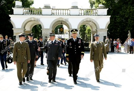 Chief of Staff of the Us Army General Raymond Odierno (2-r) Chief of the General Command of the Polish Armed Forces General Lech Majewski (2l) and Polish General Janusz Bronowicz (r) After a Wreath Laying Ceremony at the Tomb of Unknown Soldier at the Pilsudski Square in Warsaw Poland 08 June 2014 General Odierno is on a Two-day Official Visit to Poland Poland Warsaw
