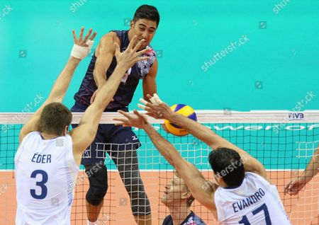 Eder Carbonera (l) and Evandro Guerra (r) of Brazil and Taylor Sander (c) of Usa During the Group J Match Between Brazil and Usa at the Fivb Volleyball World League 2016 Final Six Tournament in Krakow Poland 15 July 2016 Poland Krakow