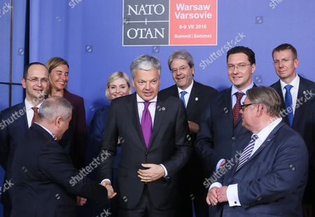 (first Row L-r) Jordanian Foreign Minister Nasser Judeh Finland's Foreign Minister Timo Soini; (second Row L-r): Albanian Foreign Minister Ditmir Bushati Belgian Foreign Minister Didier Reynders Bulgarian Foreign Minister Daniel Mitov; (third Row L-r): Eu High Representative For Foreign Affairs and Security Policy Federica Mogherini Iceland Foreign Minister Lilja Alfredsdottir Italian Foreign Minister Paolo Gentiloni Latvian Foreign Minister Edgars Rinkevics Prepare to Pose For a Group Photo During the Official Dinner of Foreign Ministers at the Grand Theatre-national Opera As a Part of the Nato Summit in Warsaw Poland 08 July 2016 the North Atlantic Treaty Organization (nato) Warsaw Summit Which is Expected to Decide About Military Reinforcements on Nato Territory in Central-east Europe Takes Place on 08 and 09 July About 2 000 Delegates Including 18 State Heads 21 Prime Ministers 41 Foreign Ministers and 39 Defence Ministers Will Take Part in the Summit Poland Warsaw