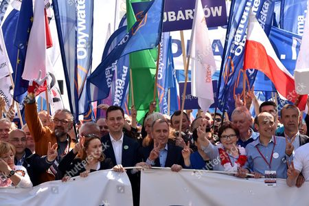 Committee For the Defence of Democracy (kod) Leader Mateusz Kijowski (3-l) Polish People's Party (psl) Leader Wladyslaw Kosiniak-kamysz (5-l) Civic Platform Leader (po) Grzegorz Schetyna (6-l) Former Polish Prime Minister Ewa Kopacz (3-r) Civic Platform Deputy (po) Borys Budka (2-r) and Polish Teachers' Union President Slawomir Broniarz (r) Take Part in the 'We Are and Will Remain in Europe' Opposition March in Defence of Democracy Organised by Polish Committee For the Defence of Democracy (kod) and Polish Opposition Parties Civic Platform (po) Nowoczesna and Polish People's Party (psl) in Warsaw Poland 07 May 2016 the March is an Expression of Support For Poland's Presence in the European Union Poland Warsaw