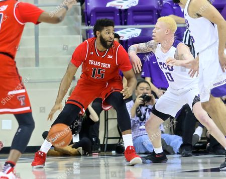 Red Raider forward Aaron Ross (15) drives ball towards hoop against TCU defender during NCAA college basketball game between Texas Tech Red Raiders and TCU Horned Frogs at Schollmaier Arena in Fort Worth Texas. TCU defeated Red Raiders 62-618