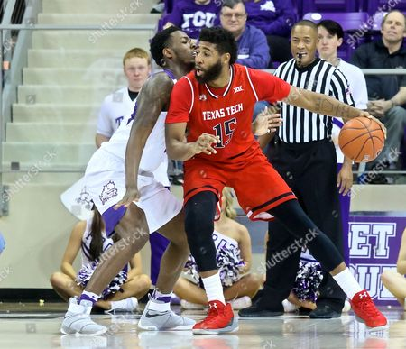 Texas Tech forward Aaron Ross {15) tries to move ball to hoop against TCU defender during NCAA college basketball game action between Texas Tech Red Raiders and TCU Horned Frogs at Schollmaier Arena in Fort Worth Texas. TCU defeated Red Raiders 62-61