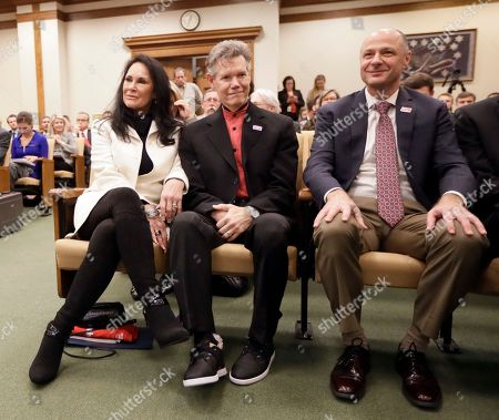 Stock Image of Randy Travis, Mary Travis, Blaise Baxter Country singer Randy Travis, center, sits with his wife, Mary, left, and Dr. Blaise Baxter, right, of Erlanger Hospital in Chattanooga, Tenn., before a meeting of the Senate Health and Welfare Committee, in Nashville, Tenn. Randy Travis, who suffered a stroke in 2013, attended the hearing for Stroke Awareness Day at the legislature. Dozens of country stars, from Garth Brooks to Kenny Rogers, are scheduled to perform at a tribute show Wednesday night in Nashville to honor Travis